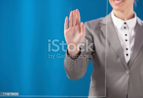 527567107 istock photo Busness woman working on transparent monitor 174979535