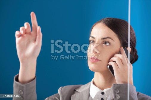 527567107 istock photo Busness woman working on transparent monitor. 174991440