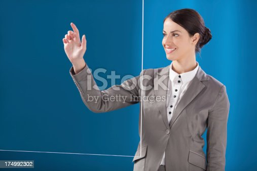 527567107 istock photo Busness woman working on transparent monitor 174992302