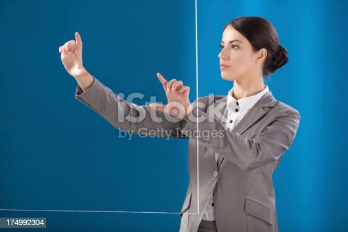527567107 istock photo Busness woman working on transparent monitor 174992304