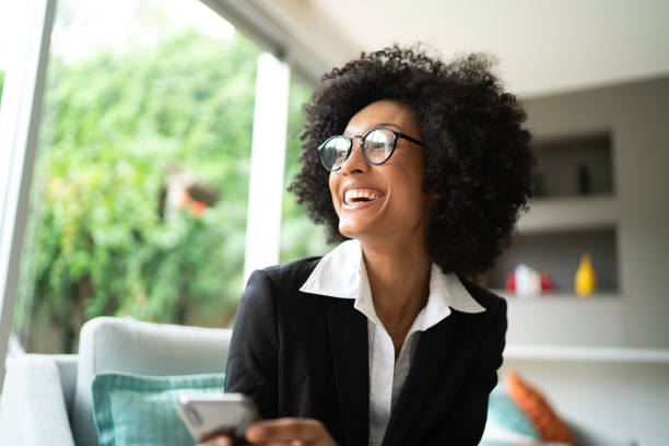 Busniness woman smiling and looking away Busniness woman smiling and looking away looking away stock pictures, royalty-free photos & images