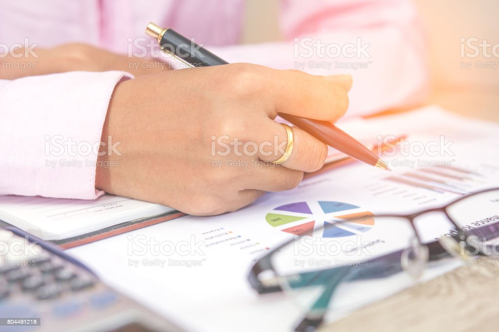 Busninessman working with graph data at office,Finance managers task,Concept business and finance stock photo