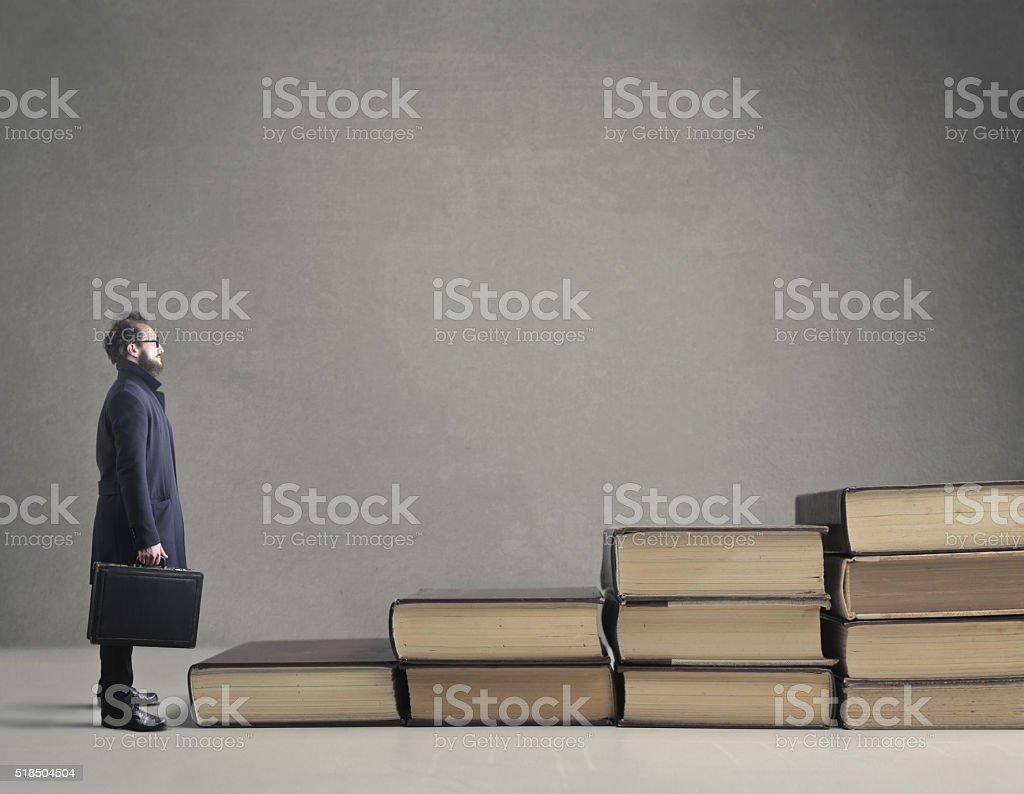 Busnisessman and books stock photo