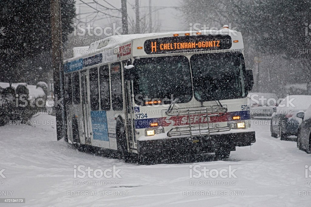 Busses stuck on steep hill due to winter weather conditions stock photo