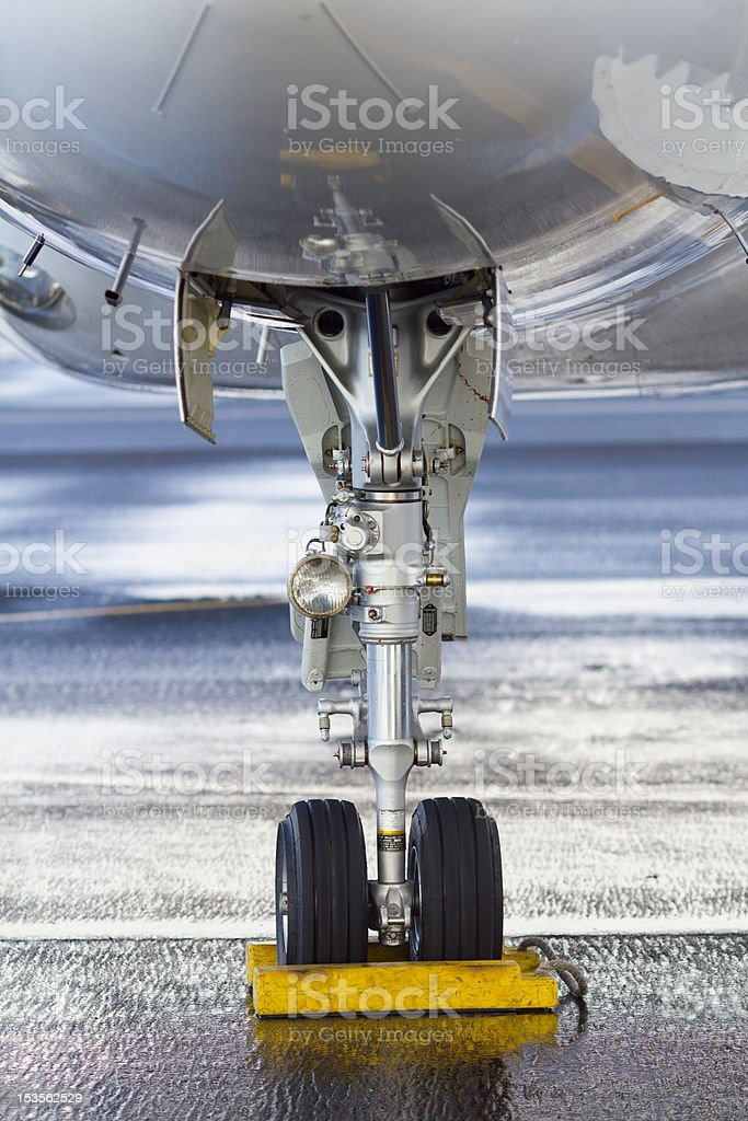 Bussines jet Falcon front landing gear royalty-free stock photo