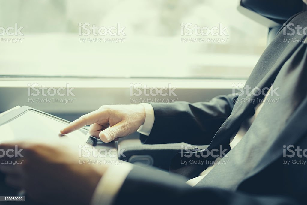 Bussinesman traveling on a train royalty-free stock photo