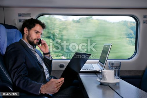 istock Bussinesman traveling on a train 464278051