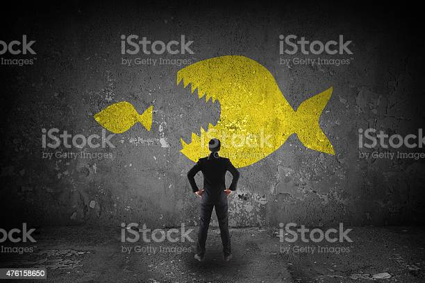 Bussiness look at a big fish eating little fish picture id476158650?b=1&k=6&m=476158650&s=612x612&h=yidd3pomkwxwohuengfuvowfsgxiyctndfbnlaawsgu=