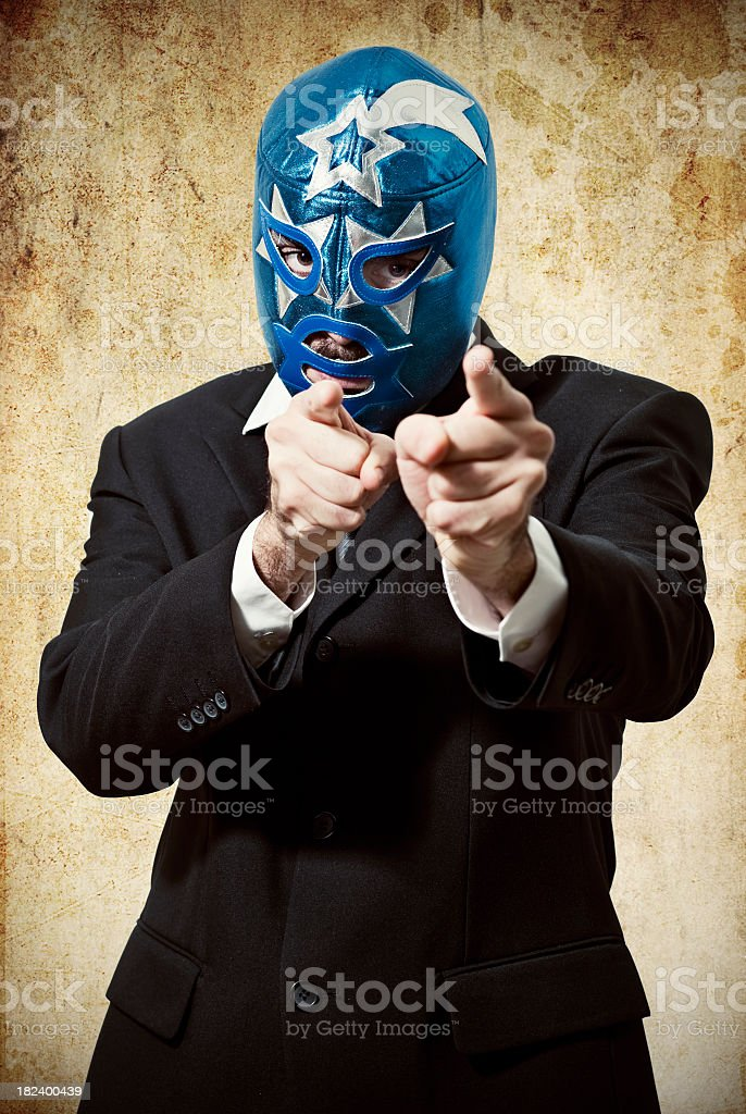 Bussiness man with a wrestling mask stock photo