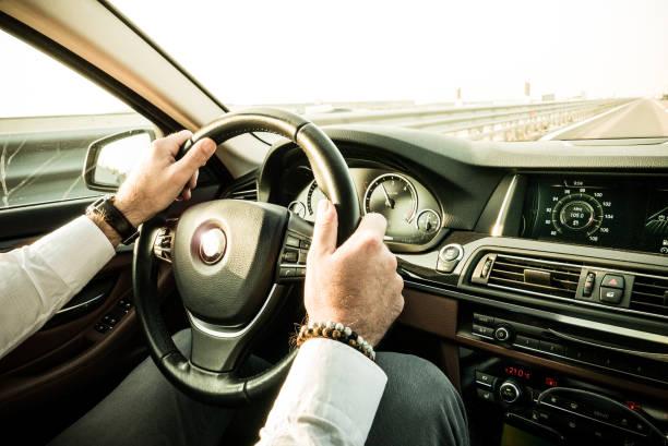 Bussinessman driving luxury car stock photo