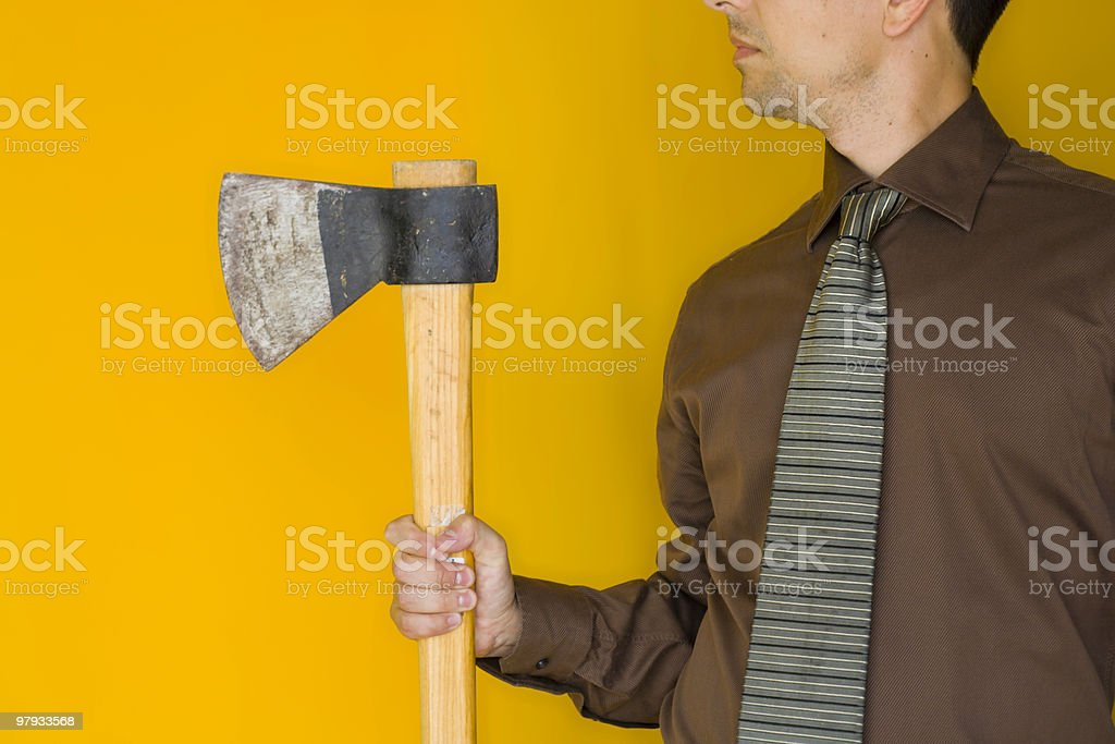 Bussinessman with a axe royalty-free stock photo