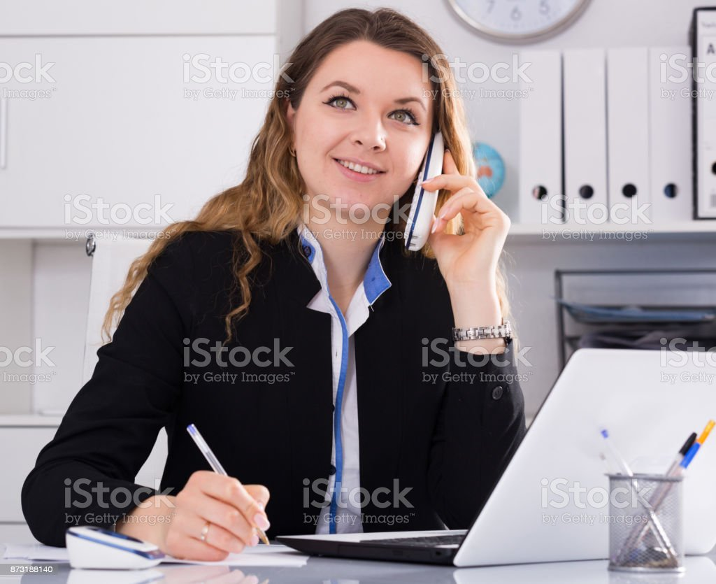 Bussineswoman filling up documents stock photo