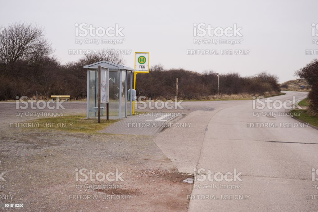 Busstop at nudist beach of Northsea island Borkum stock photo