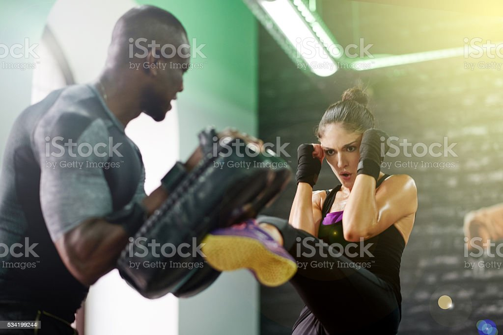 I bust mine so I can kick yours stock photo