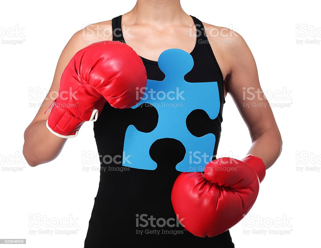 bust of a woman boxer holding a puzzle piece stock photo