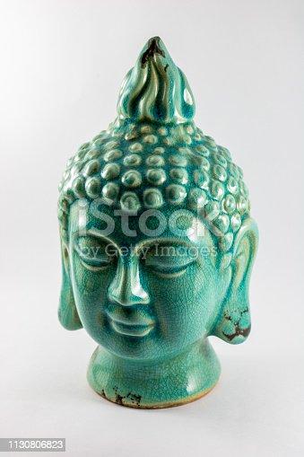 Bust of blue Buddha isolated on white background