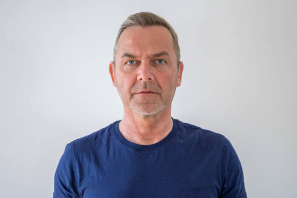 Bust portrait of middle-aged man in blue t-shirt stock photo
