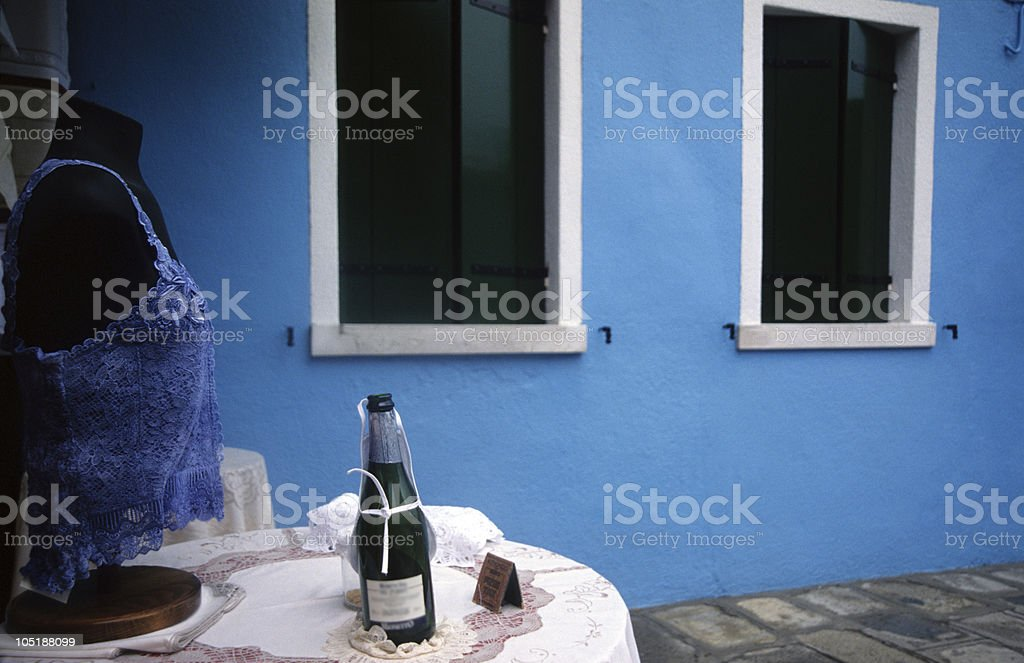 Bustier and a bottle of champagne on table, Italy royalty-free stock photo