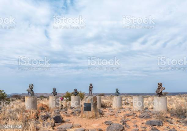 Orania, South Africa, September 1, 2018: A collection of busts of historic Afrikaner statesmen, on Monument Hill in Orania. The statue in the middle represents Afrikaner Freedom