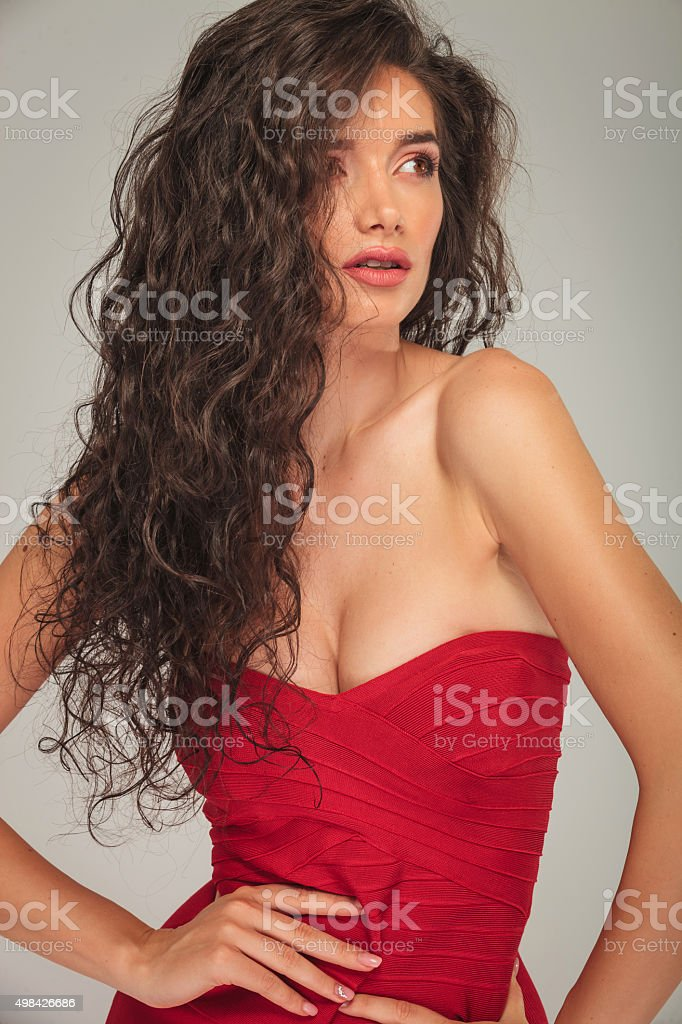 busty model with long hair touching her waist stock photo