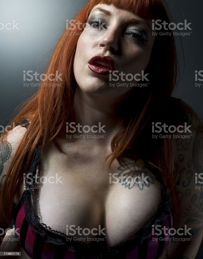Busty Orange Hair Goth Tattoo Female Retro Pin Up Model royalty-free stock photo