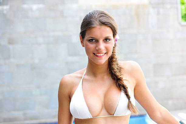 busty young woman in a spa - busty women in bikinis stock pictures, royalty-free photos & images
