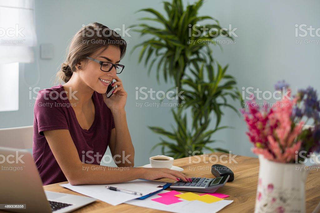 Busy accountant working at home stock photo
