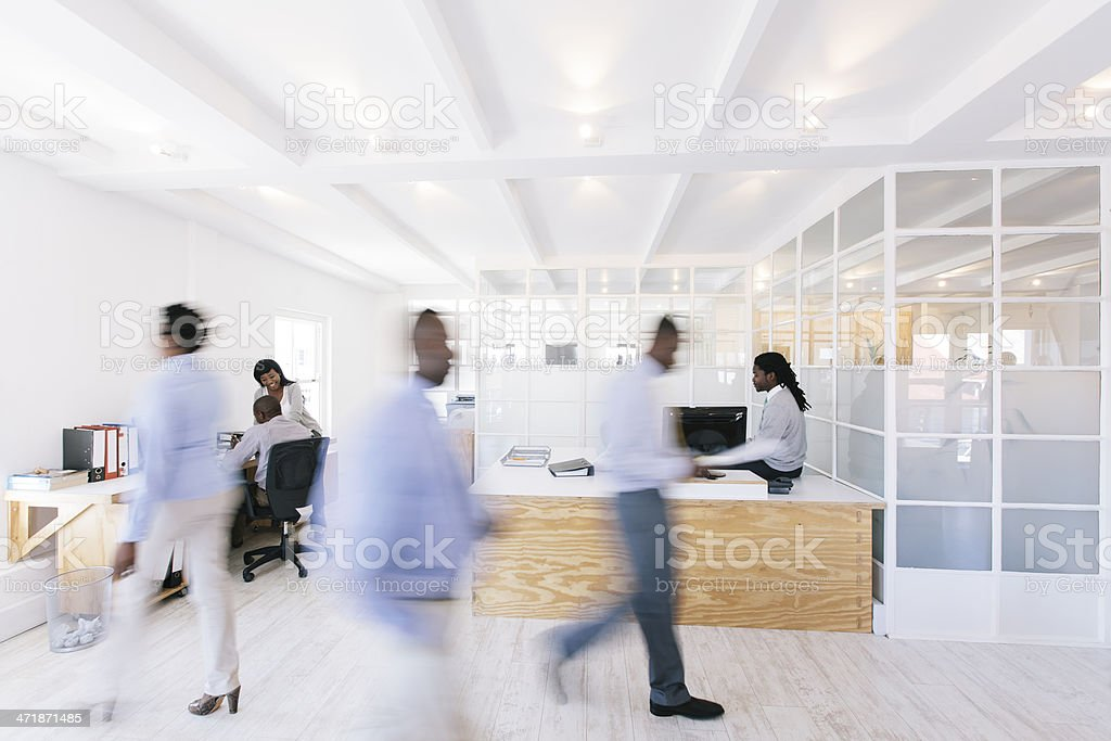 Busy African office with people walking around. stock photo