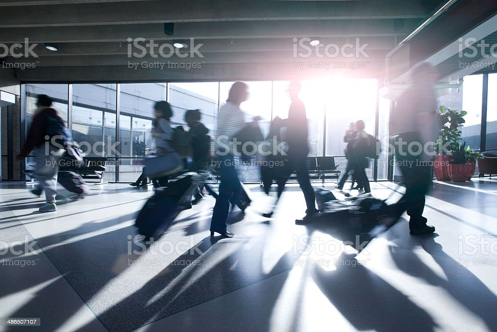 Busy Air Travelers on the Move stock photo