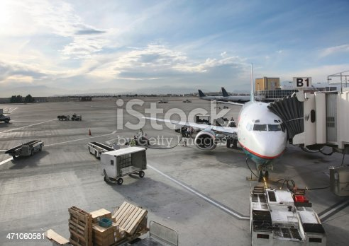 Airplane at gate being serviced in preparation for boarding, McCarran airport, Las Vegas, Nevada, USA.