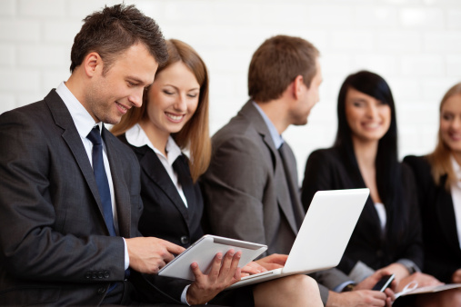 istock busy business people working digital tablet and laptop 156606110