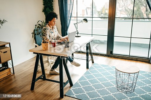 Busy business woman working from home office