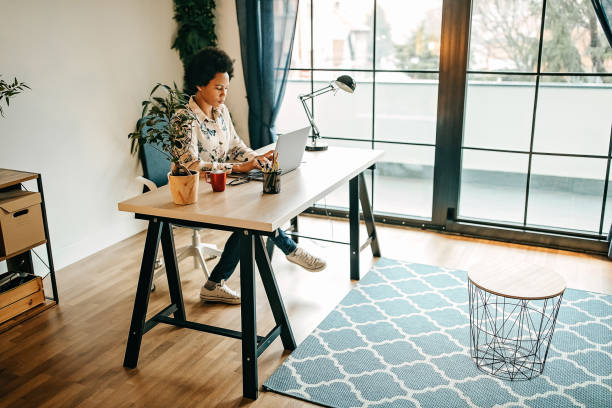Busy business woman working from home stock photo