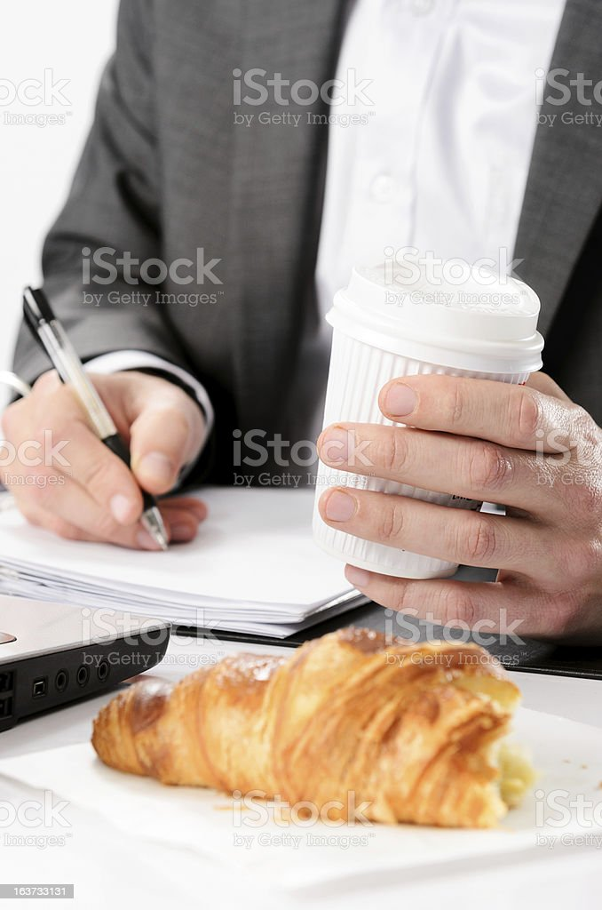 Busy businessman breakfast on the go royalty-free stock photo