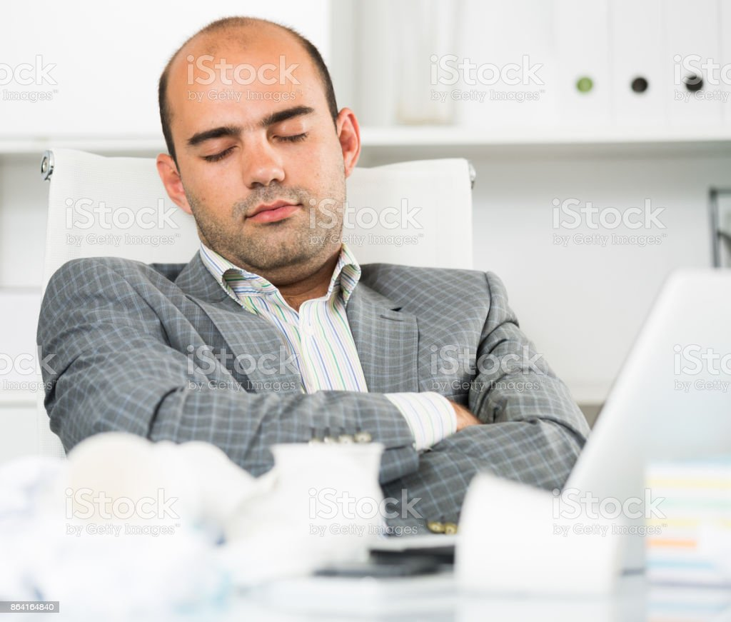 Busy businessman in shirt worrying at the computer royalty-free stock photo
