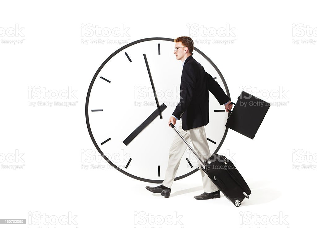 Busy Businessman Managing Time for Business Travel royalty-free stock photo