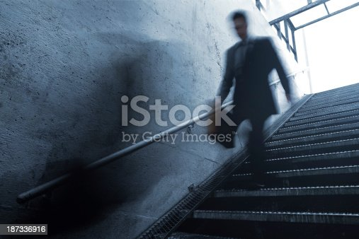 684803840istockphoto Busy Businessman Rushing Down the Stairs 187336916