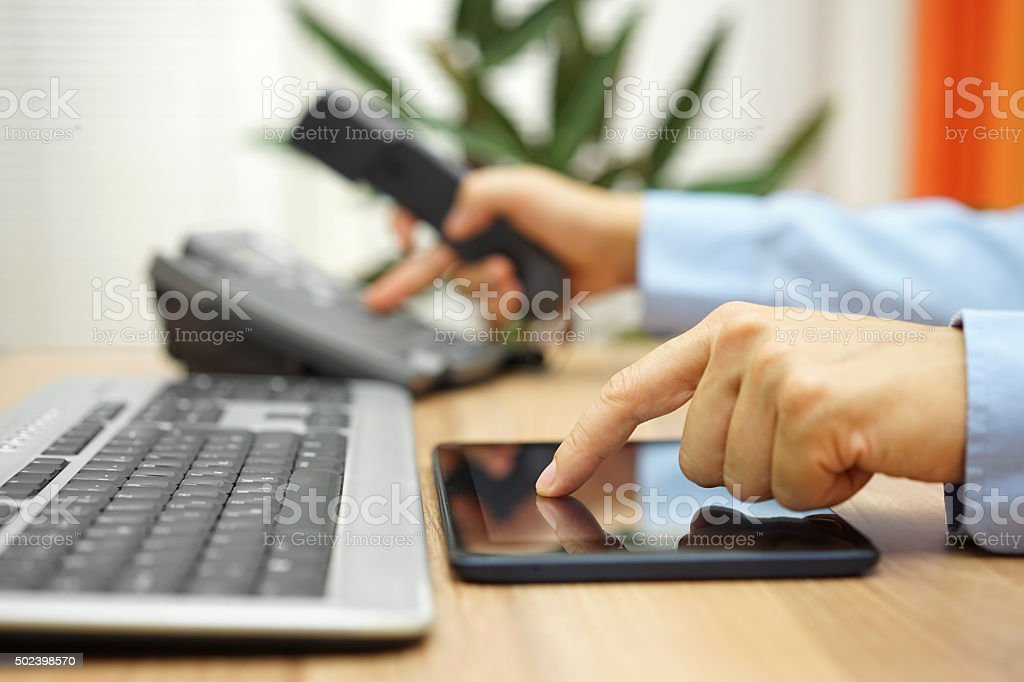 busy businessman  with tablet computer is dialing telephone number stock photo