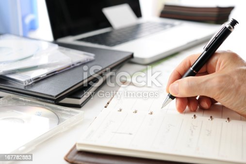 istock Busy businessman's writing a schedule 167782883