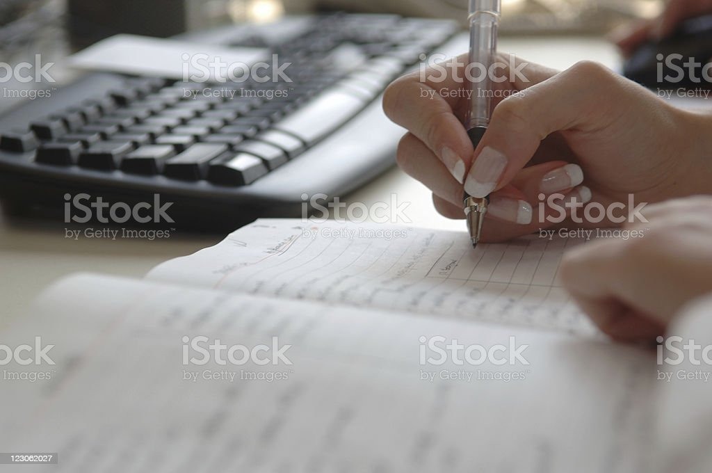 Busy businesswoman's schedule stock photo