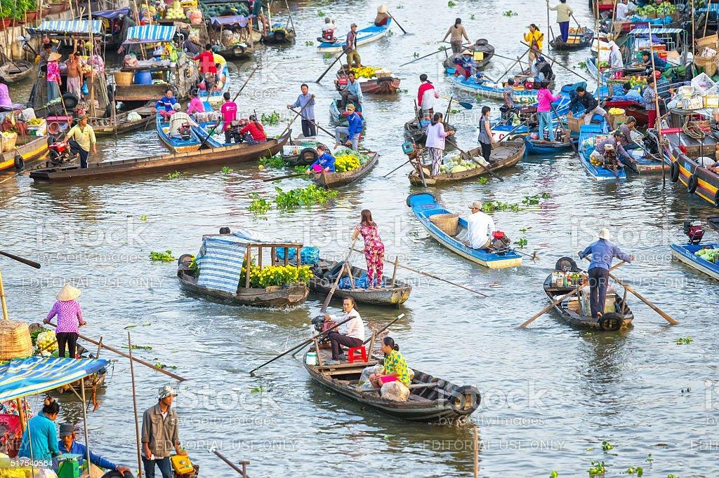 Busy bustling scene on living morning floating market stock photo
