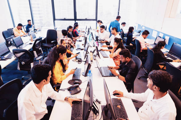 Busy Call Centre in Operation Corporate Business, Indian, Office - Group of Customer Service Executives Attending Calls at a Busy Call Centre call centre photos stock pictures, royalty-free photos & images