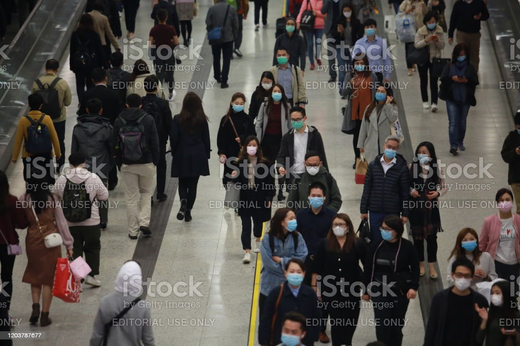 busy central station in hong kong on 2020 Hong Kong - 3 Feberary 2020: people after work go back to home through the central MTR station tunnel. central mtr station is the complex largest train station in hong kong Accidents and Disasters Stock Photo