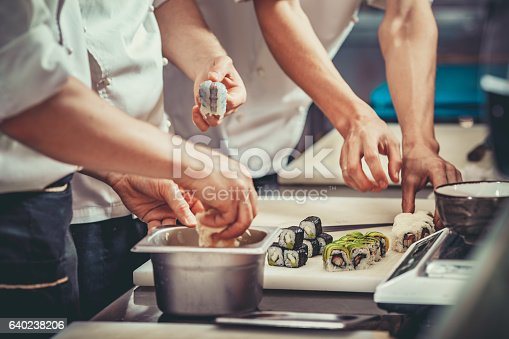 istock Busy chef at work in the restaurant kitchen 640238206