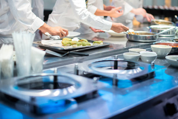 busy chefs working in kitchen - busy restaurant kitchen stock pictures, royalty-free photos & images