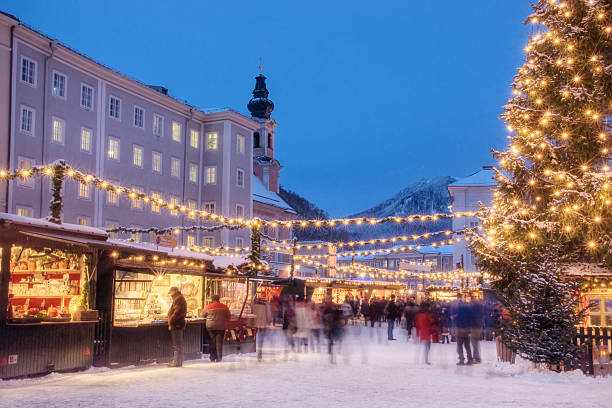 "Busy Christmas Market in Europe The famous ""Weihnachtsmarkt"" (Christmas Market) in Salzburg Austria. davelongmedia stock pictures, royalty-free photos & images"