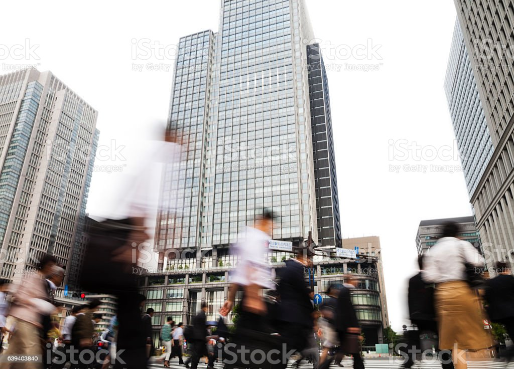 Busy City Commuters Against Office Buildings in the Morning stock photo