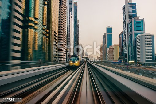 Shot of a train passing through the city