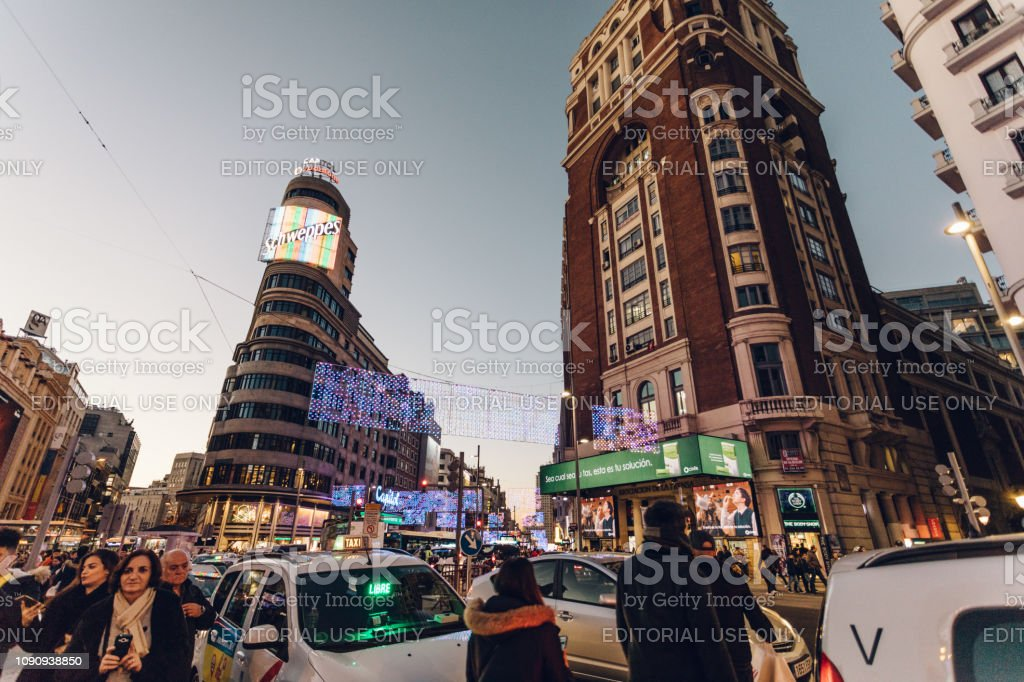 busy city streets in the evening stock photo
