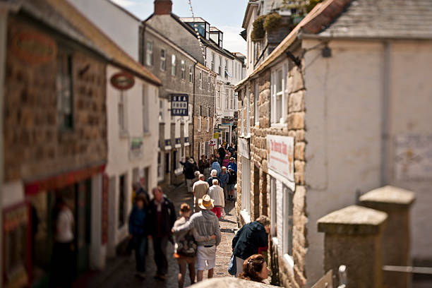 busy cobbled street in st ives cornwall - cornwall stock pictures, royalty-free photos & images